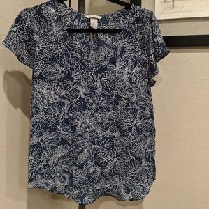 Blue and white patterned blouse